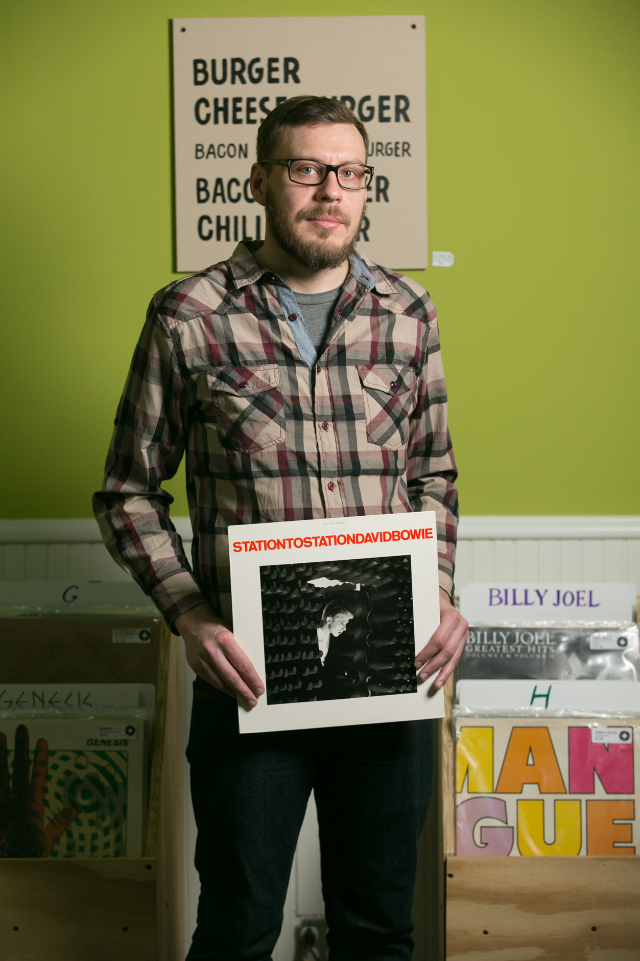 man-working-at-a-record-store